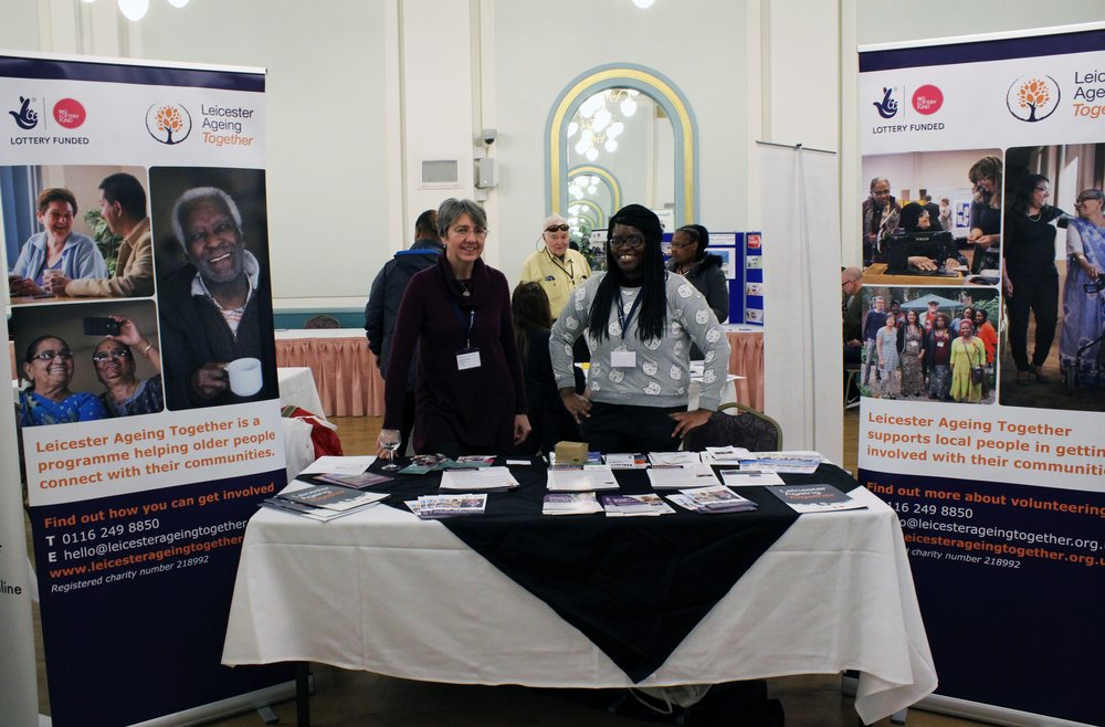 A picture of two staff members at the Leicester Ageing Together information stall.